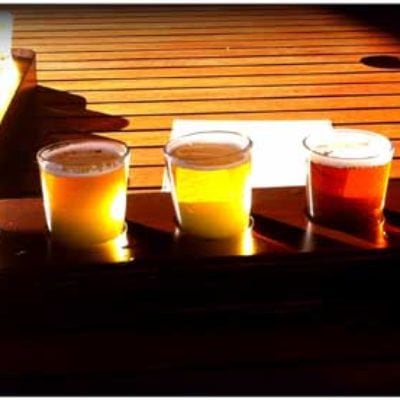 Enjoy a tasting paddle at one of the top local breweries