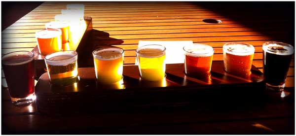Enjoy 10 tasting of beer and spirits at top local breweries and distilleries